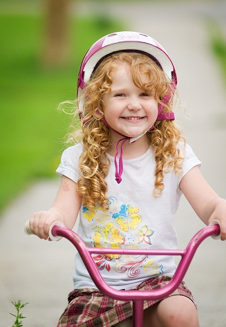 http://www.dreamstime.com/royalty-free-stock-images-happy-girl-her-bike-image18009239