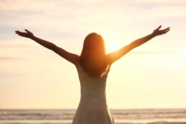 Woman Arms Raised to the Light