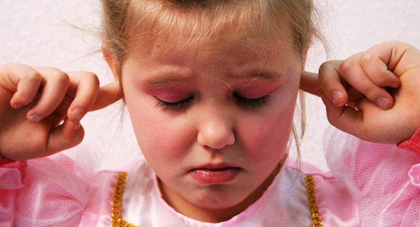 Girl plugging her ears